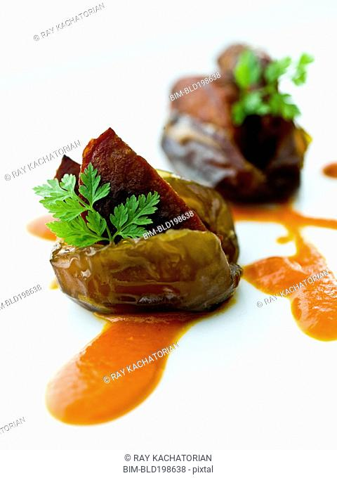 Close up of fig with chorizo in sauce