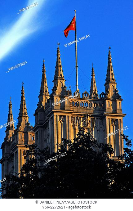 Towers of the west facade of Westminster Abbey in warm evening sunshine in London, England