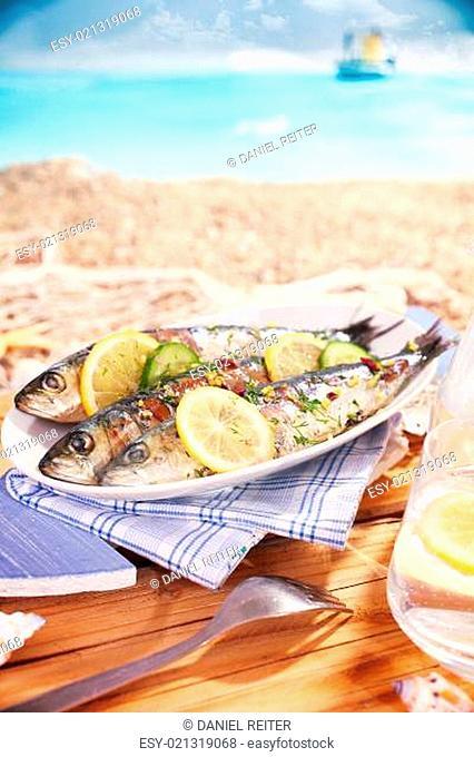 Whole garnished pan fried fish