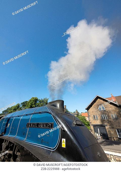 The vintage A4 Class steam locomotive Sir Nigel Gresley at Grosmont station on the North Yorkshire Moors Railway,near Whitby, North Yorkshire, UK