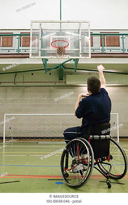 Disabled man playing basketball