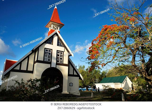 Notre Dame aux Iliatrice Chapelle with red roofed, seafront catholic church, Cap Malheureux, Mauritius