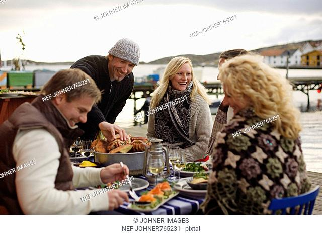 People at a dinner party outdoors, Sweden