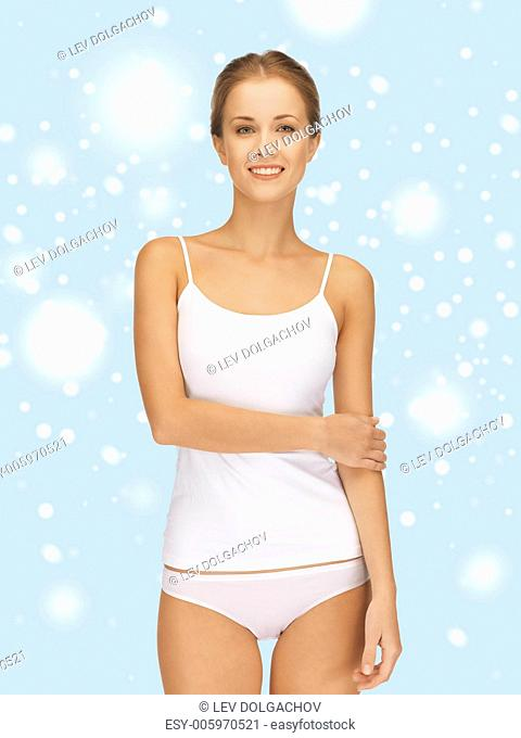 health, beauty, spa and happiness concept - beautiful woman in white cotton undrewear