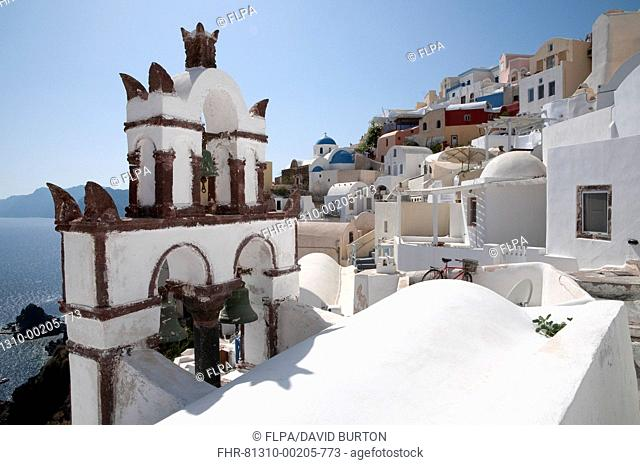 Orthodox church bell tower, in town on coastal clifftop, Oia, Santorini, Cyclades, Aegean Sea, Greece, September