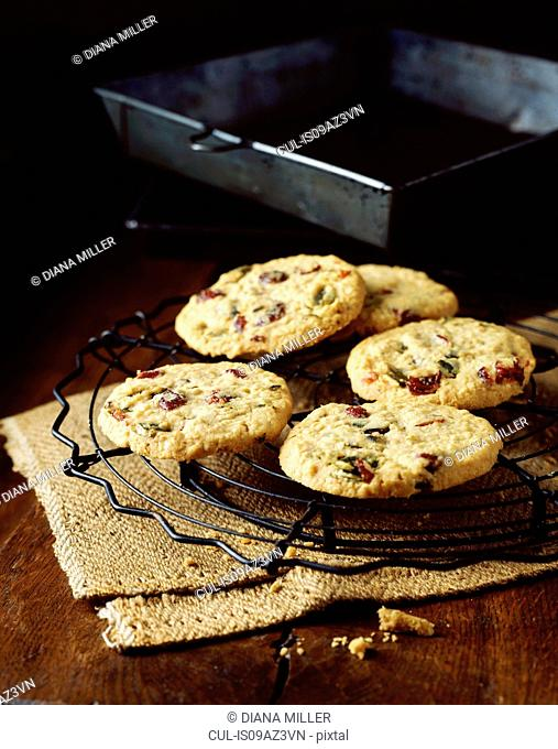 Pistachio and cranberry oat cookies, vintage props, wooden table