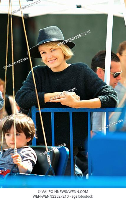 Malin Akerman takes her son to the Studio City Farmers Market during Memorial Day Weekend. They rode the swings and hopped a ride on the train