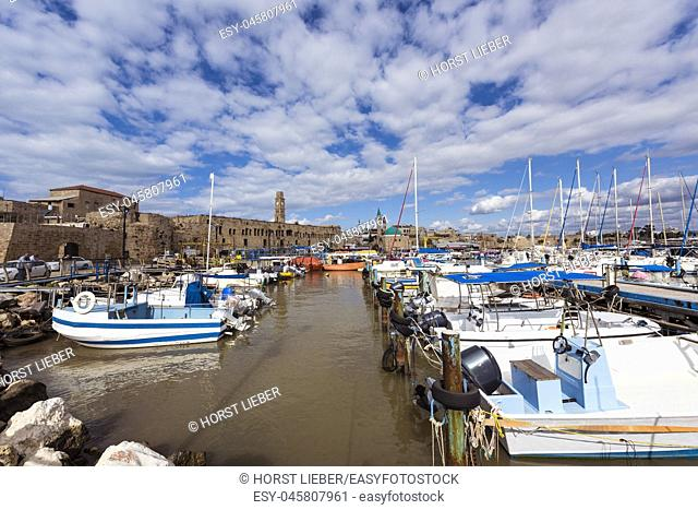View on marina with yachts and ancient walls of harbor in old city Acre, Israel, Middle East