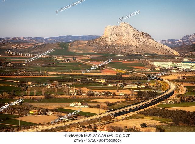 """Roads around Antequera with 880 metre Peña de los Enamorados (""""""""The Lovers' Rock"""""""") mountain in the background. . Viewed from Ermita de la Veracruz"""