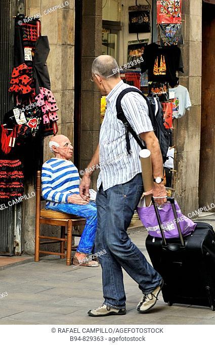 Tourist and Pablo Picasso figure in Carrer Montcada, Barcelona. Catalonia, Spain