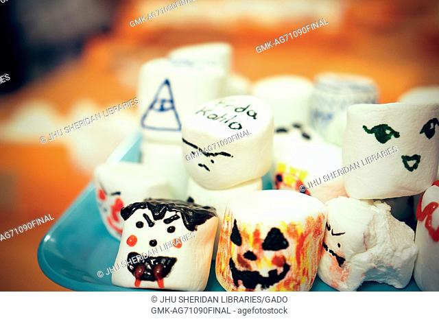Close up photo of a plate of large marshmallows that have been decorated with faces, Halloween at Johns Hopkins University's George Peabody Library, 2015