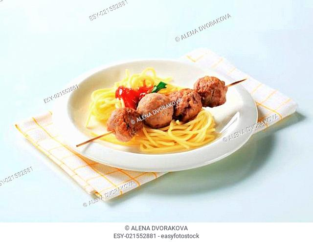 Meatballs on skewer with spaghetti