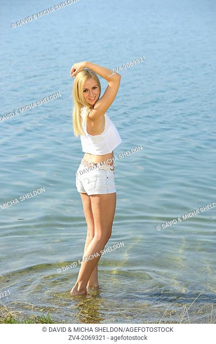 Young woman at the shore of a lake, Austria