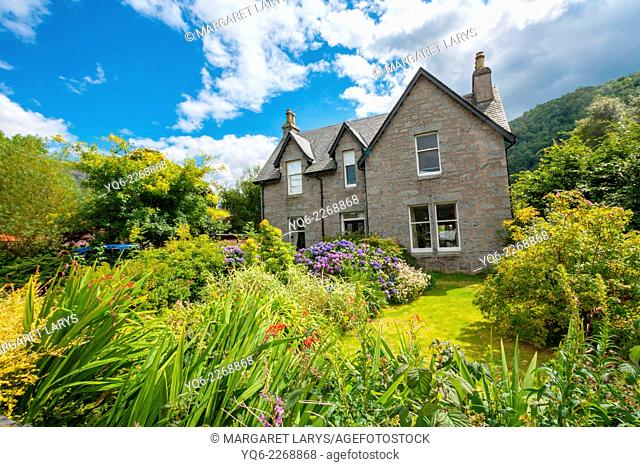 Beautiful house and a garden in the village of Glencoe, Scotland