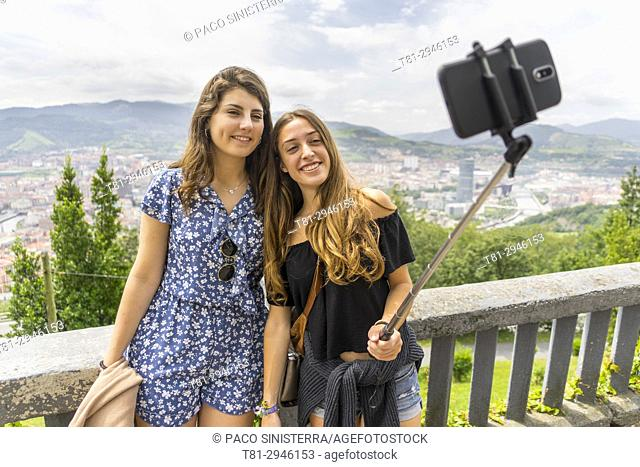 two girls taking a photo in Bilbao. Biscay, Spain, Europe