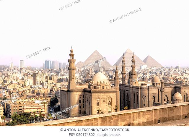 View on the Mosque-Madrassa of Sultan Hassan in Cairo and the Pyramids of Giza, Egypt