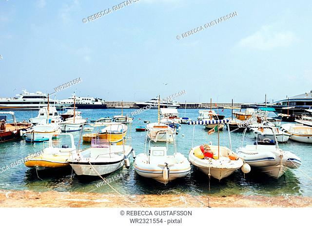 Boats moored on shore at Marina Grande against sky