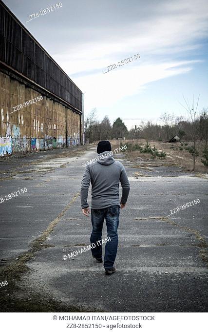 Rear view of a man walking away outdoors