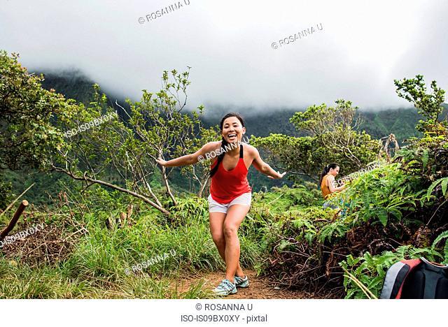 Hikers enjoying rainforest, Iao Valley, Maui, Hawaii