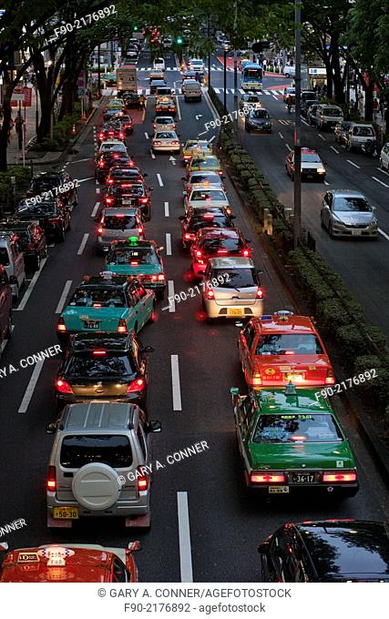 Taxi traffic in the evening in Omotesando, Tokyo, Japan