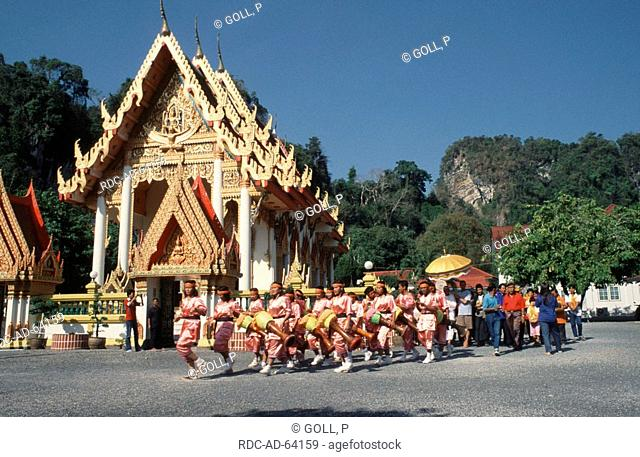 People at marriage ceremony and musicianss at temple Wat Phrachumyothi Phang Nga Thailand