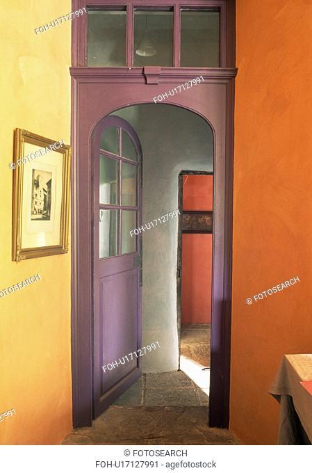 Purple door in orange hall