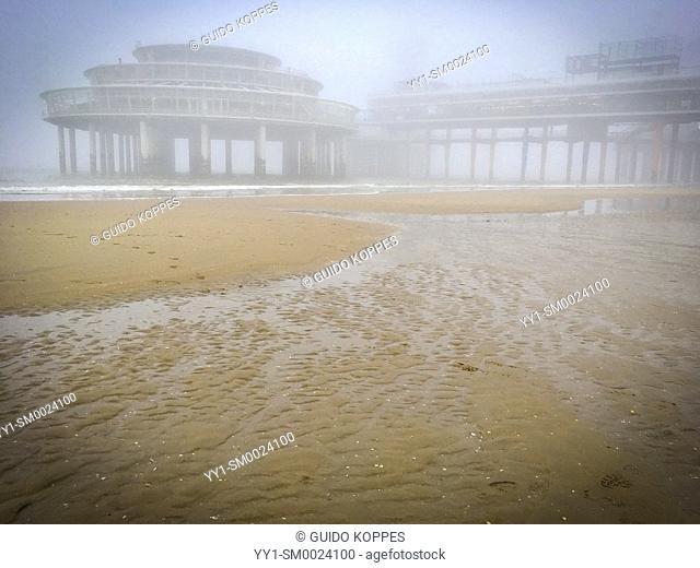 Scheveningen, Netherlands. The famous and iconic Pier at Scheveningen Beach during a foggy, winter day