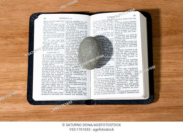 Stone on open Bible