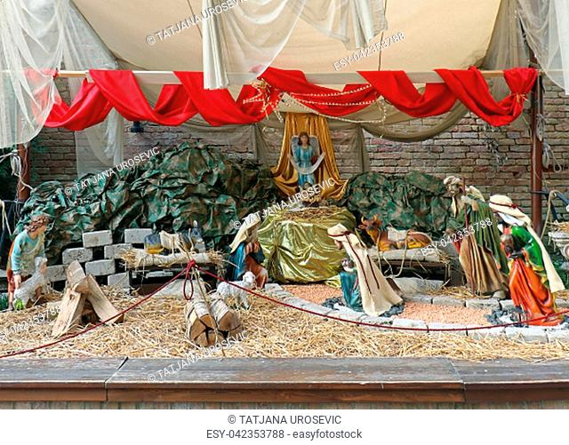 Birth of Jesus in native religious bible scene inside barn with decorative figurines