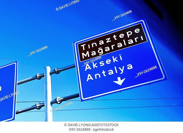 Motorway highway direction sign to Antalya Akseki seen through automobile window at intersection in Seydisehir, Anatolia, Turkey