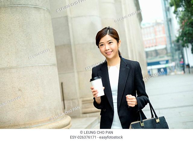 Asian businesswoman walking at the street in Hong Kong