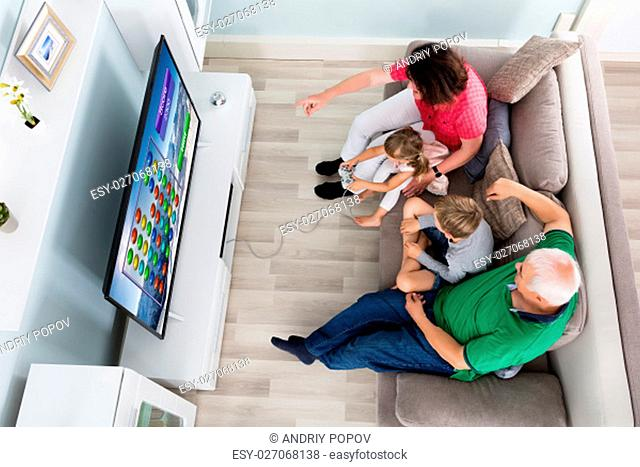 Family Playing Videogame On TV Together At Home