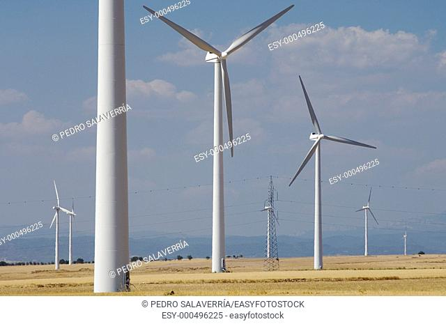 group of windmills with cloudy sky