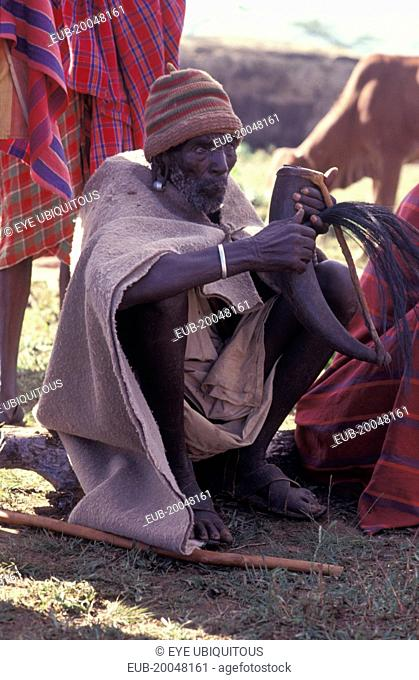 Gourds filled with honey beer are drunk at the beginning of the an initiation ceremony that will bring the young Maasai Moran or young warriors into manhood