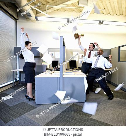 Business people cheering in cubicles
