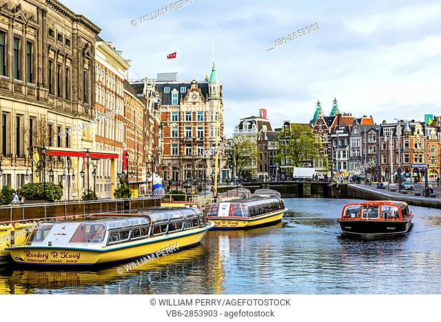 Tour Boats Reflection Canal Amsterdam Holland Netherlands. Canals in Amsterdam create beautiful abstract reflections