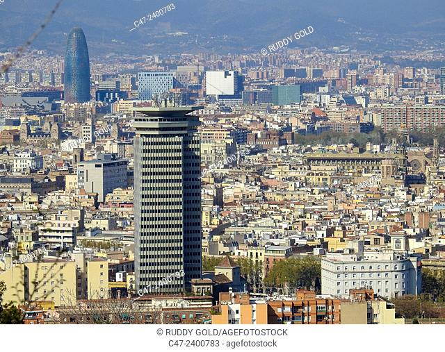 Colon building in foreground and Agbar tower in background, Barcelona, Catalonia, Spain