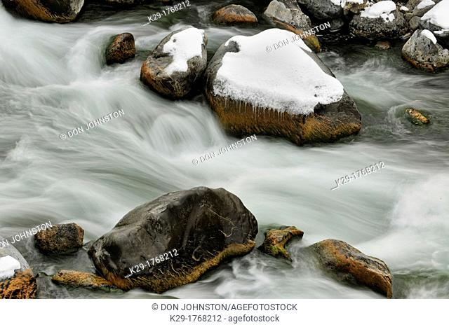 Fresh snow, boulders and rapids in the Gardner River, Yellowstone NP, Montana, USA