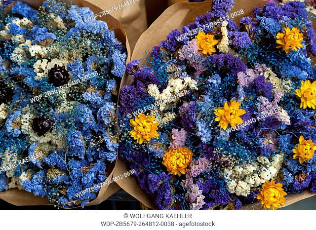Colorful dried flower bouquets for sale at the Pike Place Market in Seattle, Washington State, USA