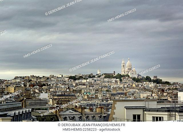 France, Paris, Sacre Coeur and the hill of Montmartre after rainfall