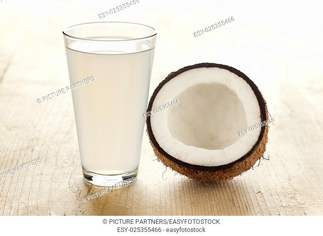 Coconut with a glass of fresh coconut water