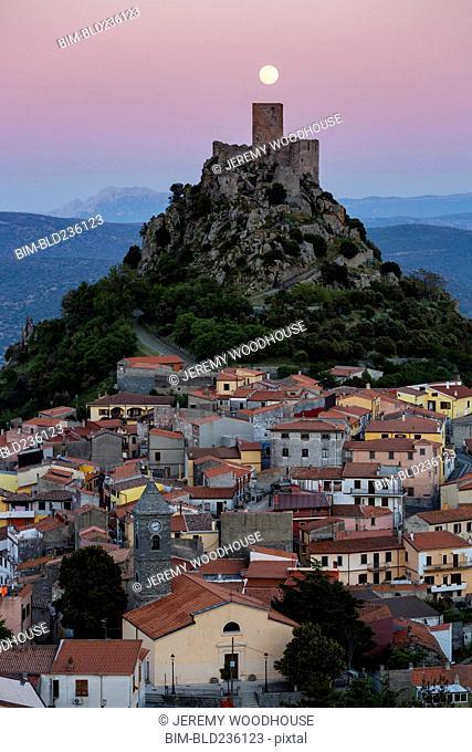 Castle on hill under full moon, Burgos, Sassari, Italy