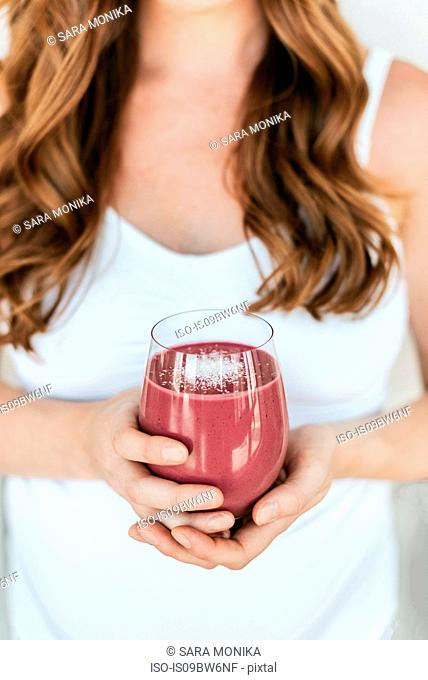 Pregnant woman with glass of smoothie