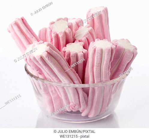 striped sweet marshmallows stuck in a bowl