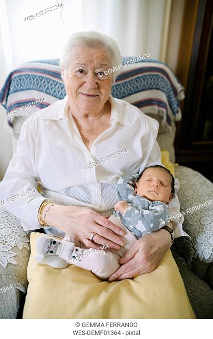Portrait of great grandmother with her great granddaughter at home