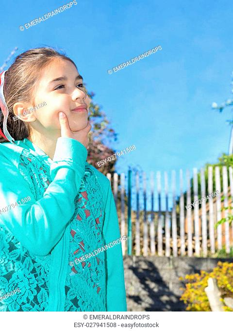 Young girl outside thinking and enjoying the day