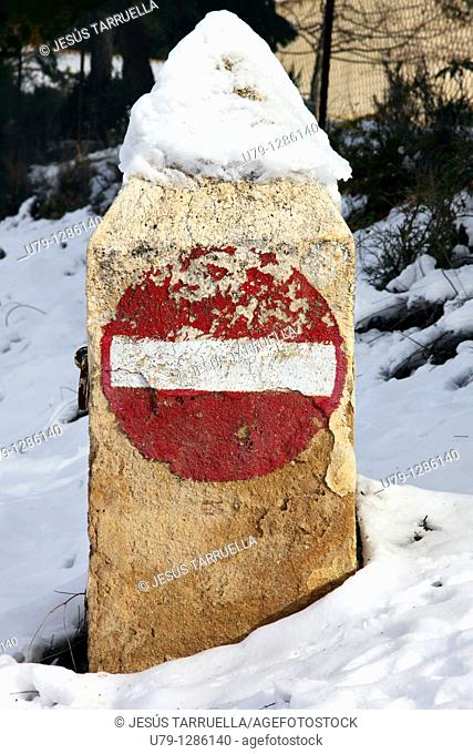 Old road sign snow