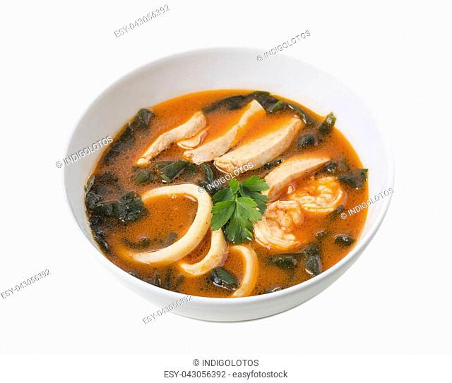 Delicious Thai tom yum soup with seafood and chicken. Isolated on a white background
