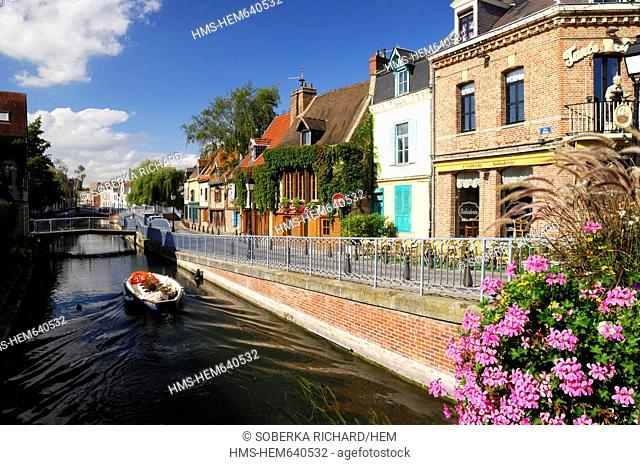 France, Somme, Amiens, St Leu district, tourist boat in front of Quai Belu and cafe restaurant terraces