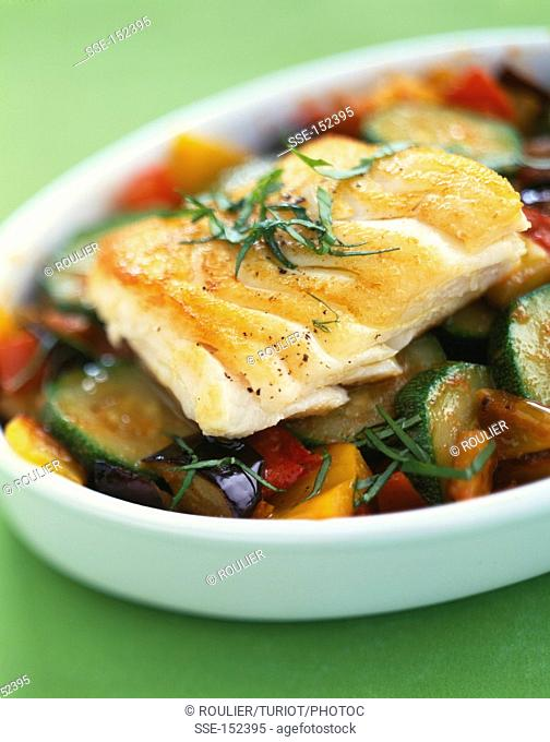 Piece of hake with summer vegetables